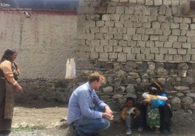 Traveler photo: Our client is talking with local Tibetan children. (June 2020)