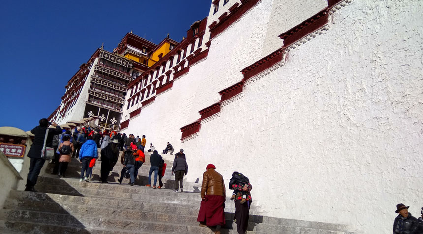 Climb steps to the Potala Palace