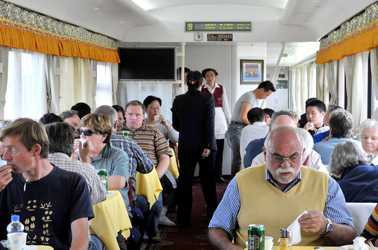 Passengers dining in the dining car