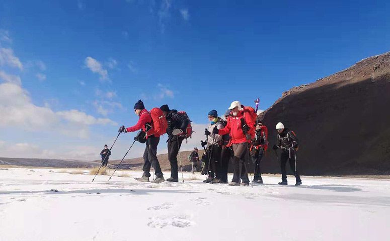Trekking on the snowy Mount Kailash is challenging.