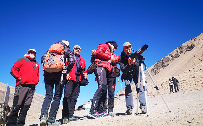 Use the telescope to see distant scenery during the trekking.