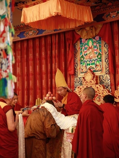 "The awarded monks with ""Tho Ram Pa"" degree and ""Nzhing Ram Ba"" degree  pay homage to the 11th Panchen Lama on May 18."