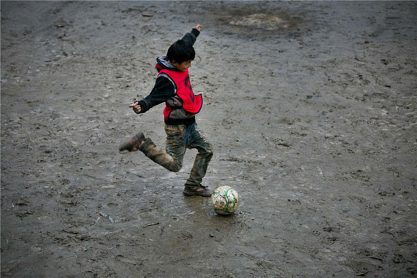 Dorjie Tsering plays football at the school. One about one year, the 11-year-old fifth grader will attend middle school at the county far away. Dorjie said his biggest wish was being able to play football with his friends forever.