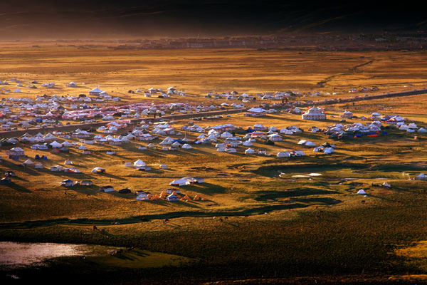 Tibetan style houses on Litang grassland in Litang County of Garze Tibetan Autonomous Prefecture in Sichuan Province.